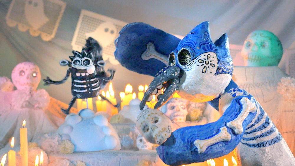 Rigby & Mordecai dancing and eating sugar calaveritas!