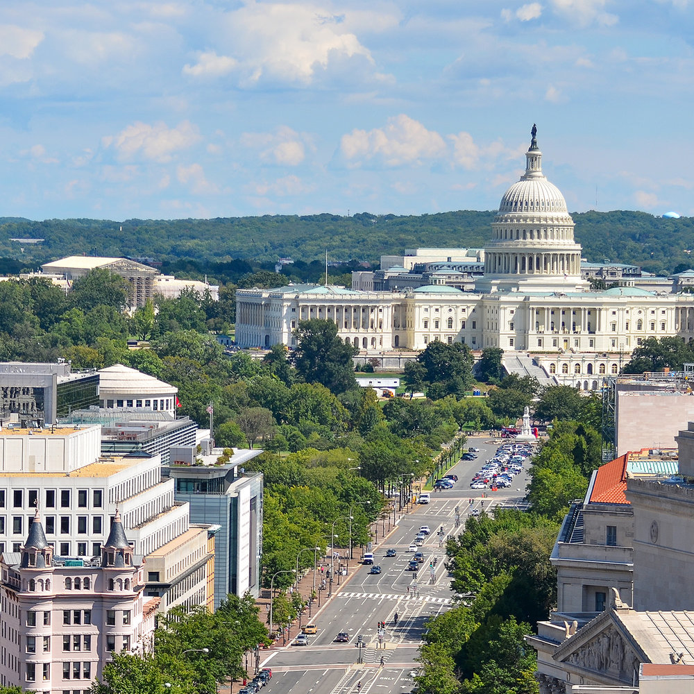 Aerial shot looking down Pennsylvania Avenue to the U.S. Capitol Building
