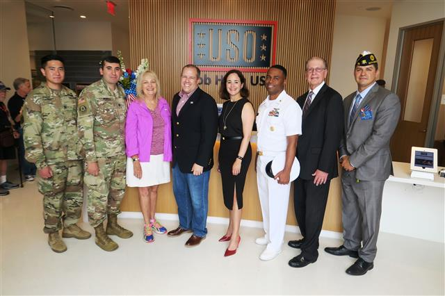 From left, CPT Sung Chung, CPT Christopher G. Montes, Los Angeles Board of Airport Commissioners Vice-President Valeria Velasco, Bob Hope USO President Bob Kurkjian, Delta Air Lines Managing Director of Government Affairs Dana Debel, Master Chief Petty Officer Lloyd Roberts, Wayne Kauffman, Bob Hope USO Board Member, and Noe G. Aguirre,1st Vice Commander Post 283 were on hand to mark Bob Hope USO's move into its new home at the Theme Building at LAX on Friday morning.