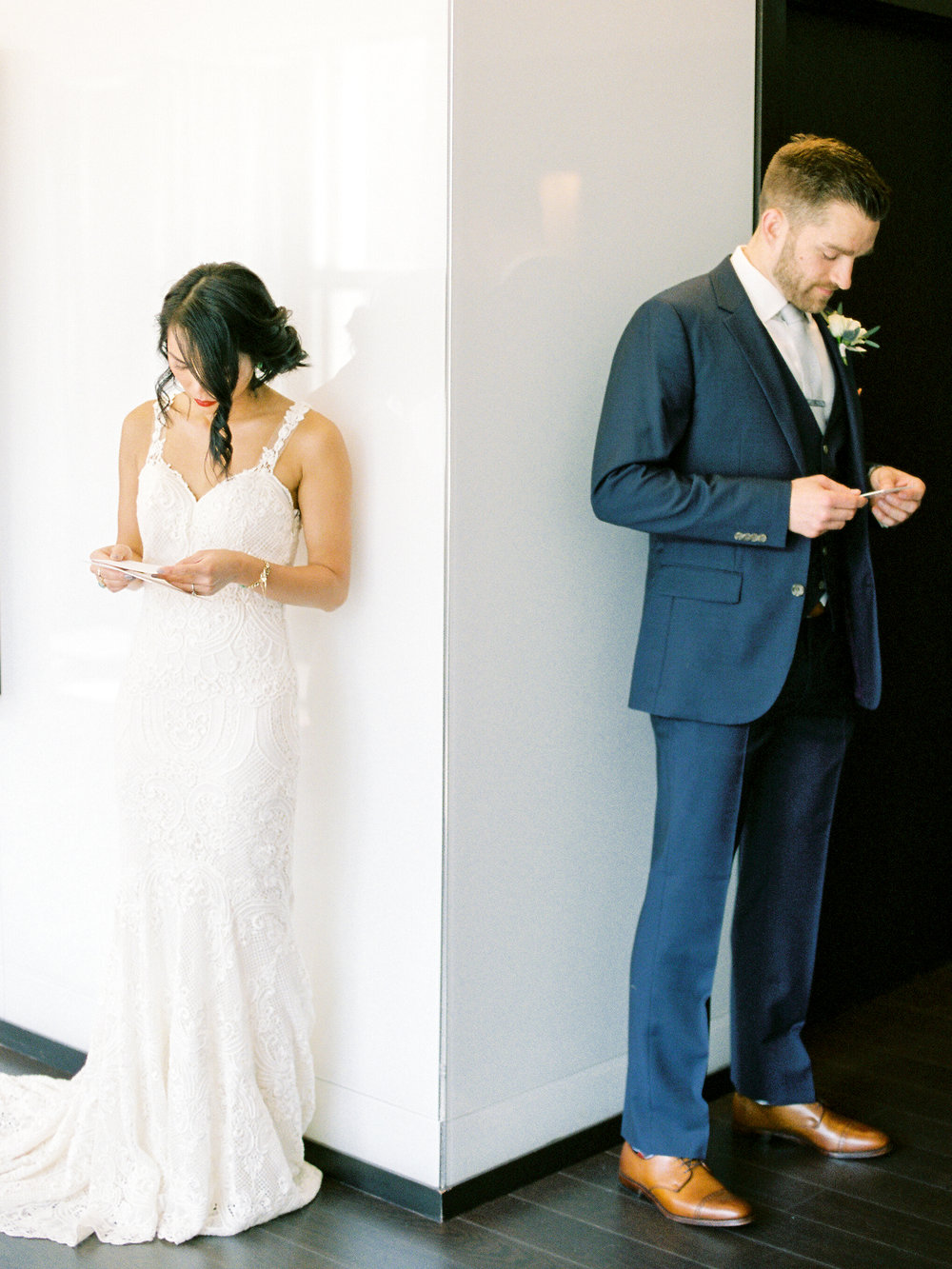 A bride and groom's first look at their Portland riverfront wedding