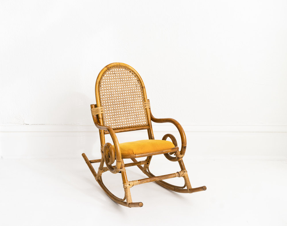 Kids vintage rattan, bamboo and cane rocking chair   $125