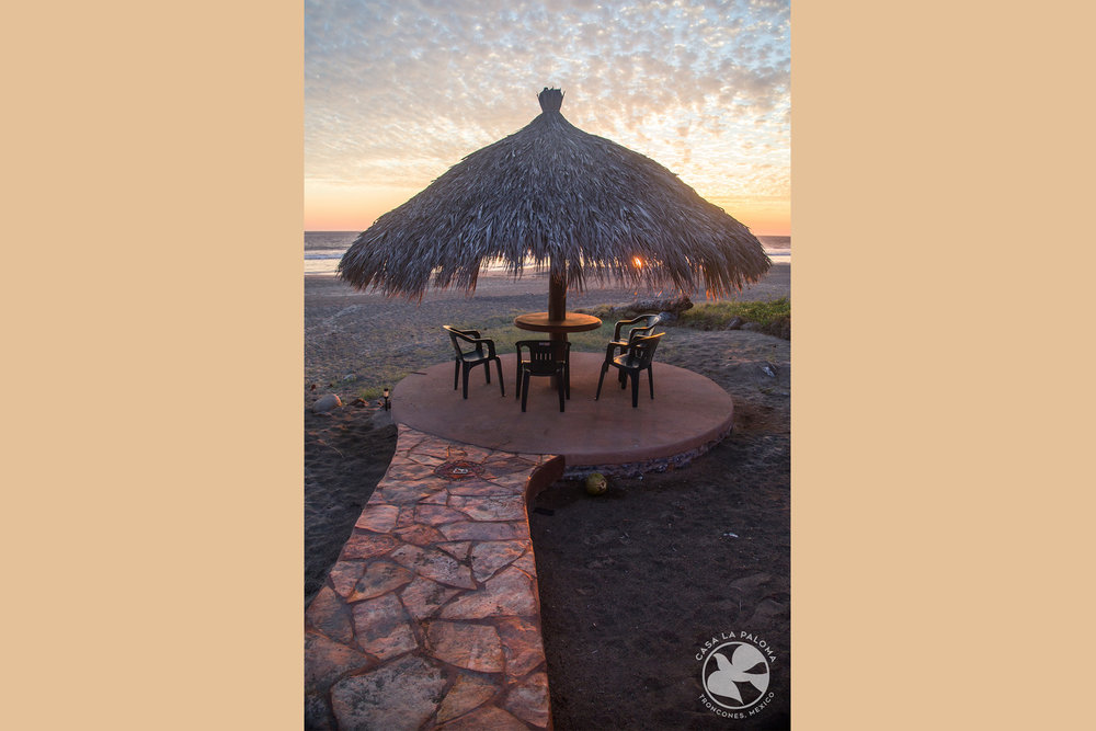 Palapa with table and chairs