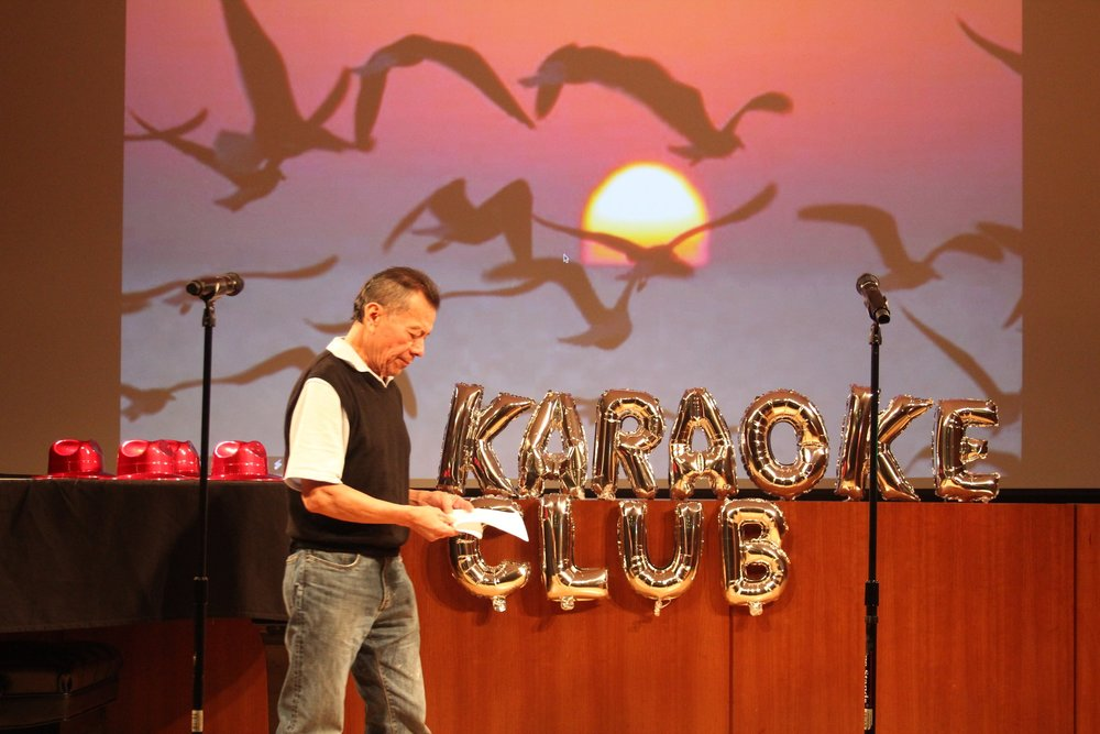 KARAOKE CLUB - A facilitation and program to create a safe space for immigrants to learn English through music.