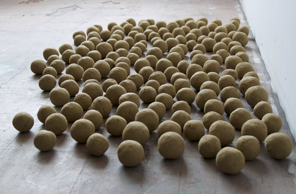 "Self-portrait, 171 Dirt Balls  Each ball 3"" - Assembled dimensions vary  Dirt  (2015)"