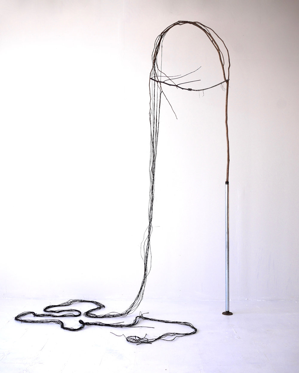 "Descent  9' x 36"" x 6""  Tree branch, twine, fabric dye, found metal pieces  (2016)"