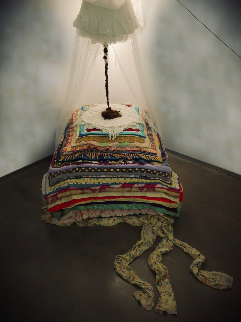 """Her Boredom Is Exquisite and Excessive. In Her Is The End of Breeding.   128"""" x 204"""" x 228"""" - dimensions variable  Shadow wallpaper, 197 pounds of used blankets, my mother's hair, lace, crinoline underskirt, fur, mosquito netting, scent of oak moss  (2018)"""