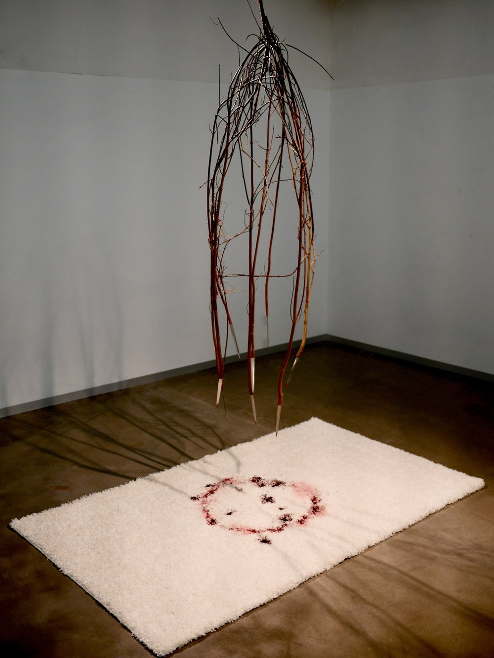 "Sapling Revolt   126"" x 72"" x 48""  Manipulated found wood, dagger blanks, white shag carpet, dye, acrylic paint  (2018)"