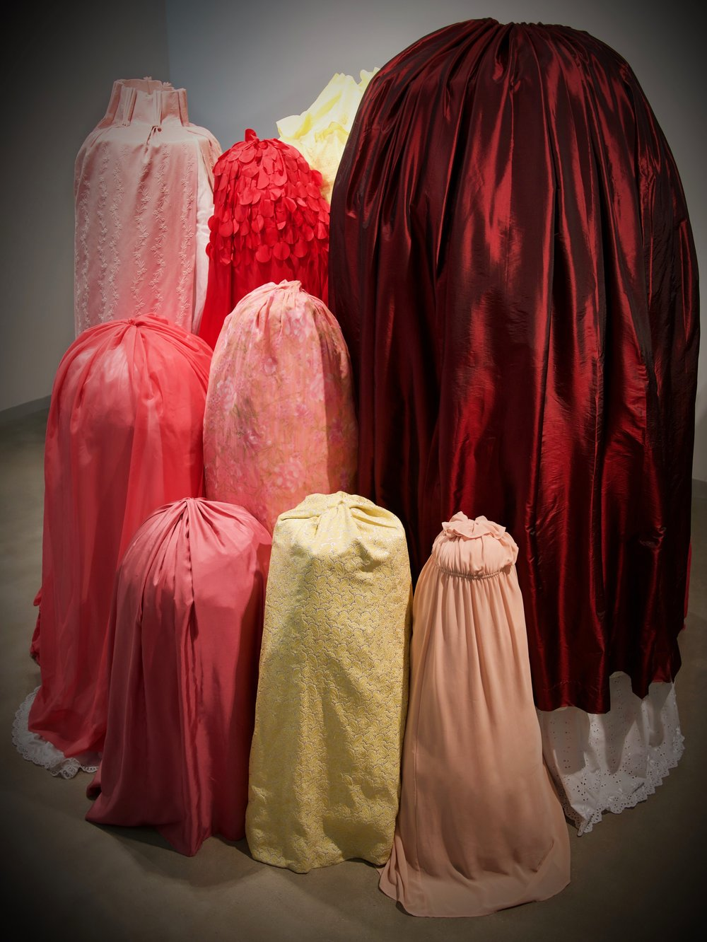 """Open Secret   105"""" x 120"""" x 100"""" - dimensions variable  Used garments, used household linens, touch sensitive vibrating motor, manufactured cherry scent  (2019)"""