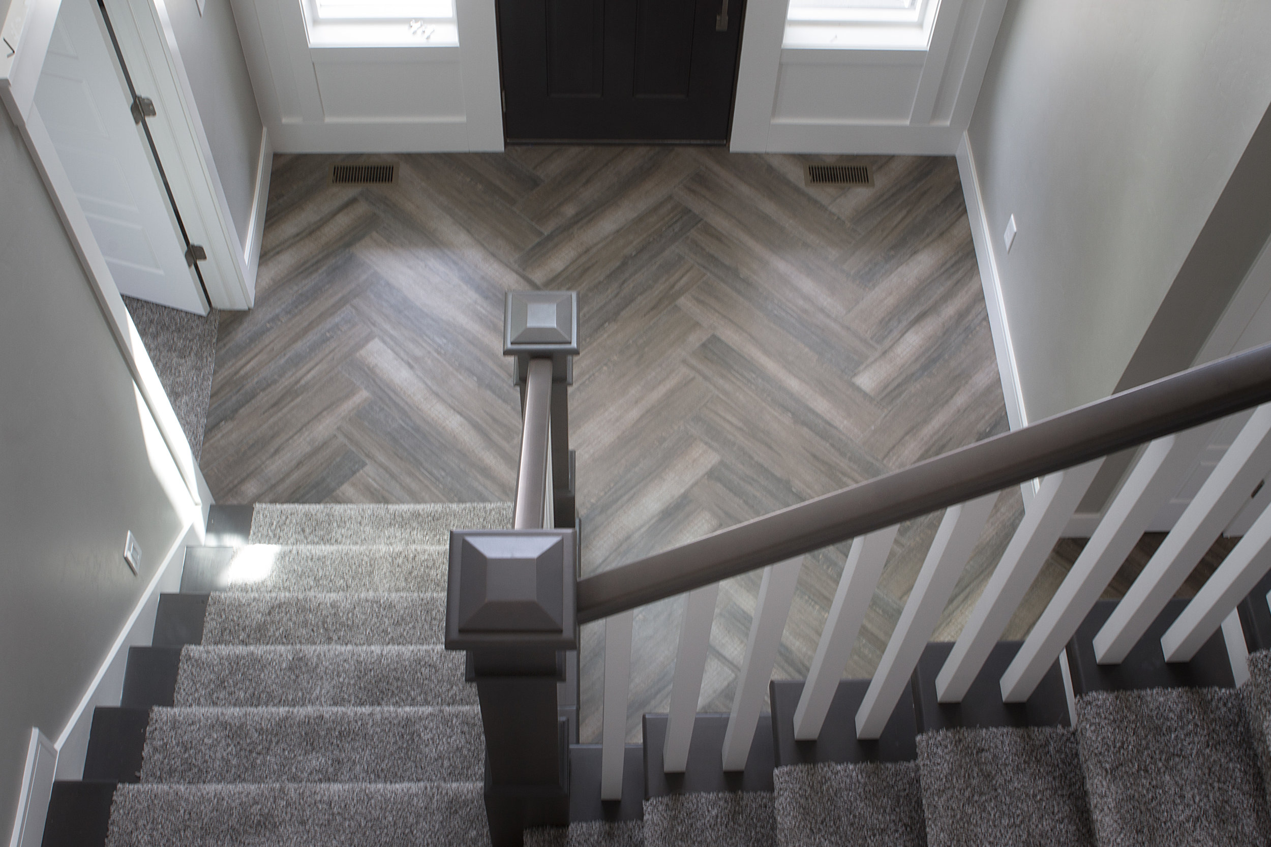 Herringbone Wood Texture Tile Floor Installation Kitchen Entry