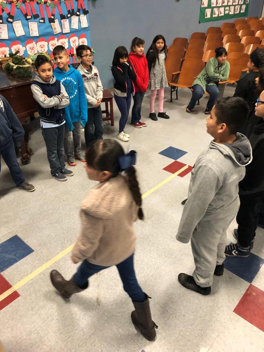 Finding Unseen Commonalities  Students participate in a stand-on-the-line game to learn what they have in common with their peers that they may not have previously realized