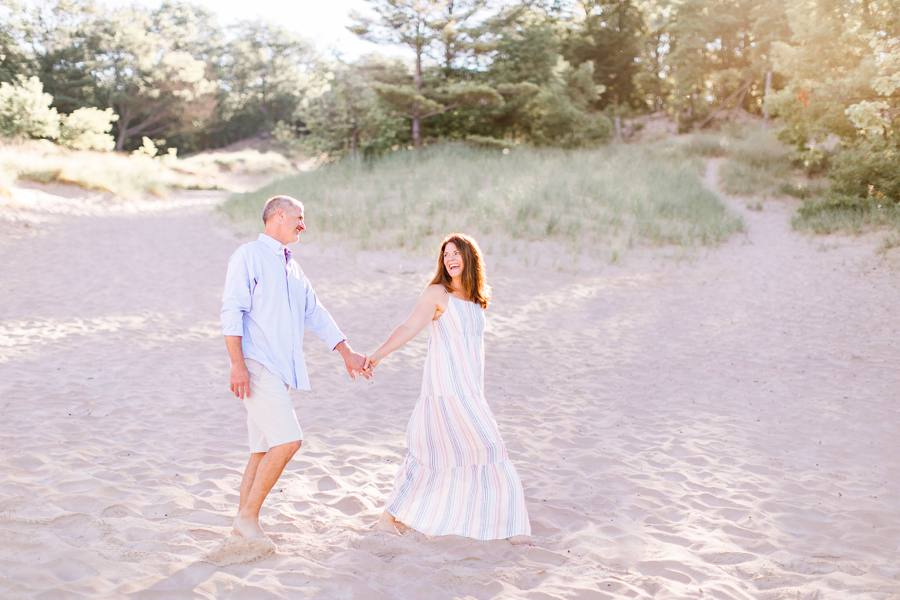 Grand Haven, MI couple walking on beach family photographer Elm & Olive