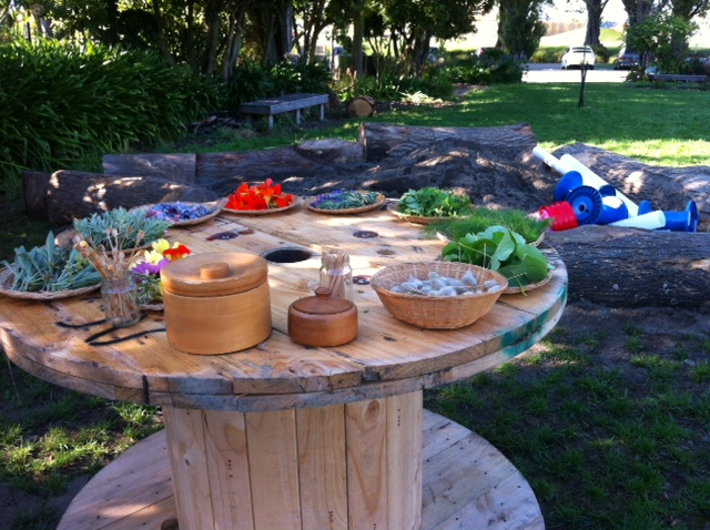 Herbs and edible flowers are perfect for mud kitchens. Check op shops for beautiful wooden bowls and baskets to display them in.