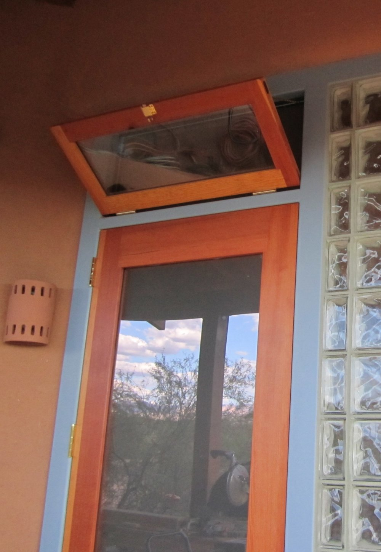 Douglas fir transom window and door in steel frame