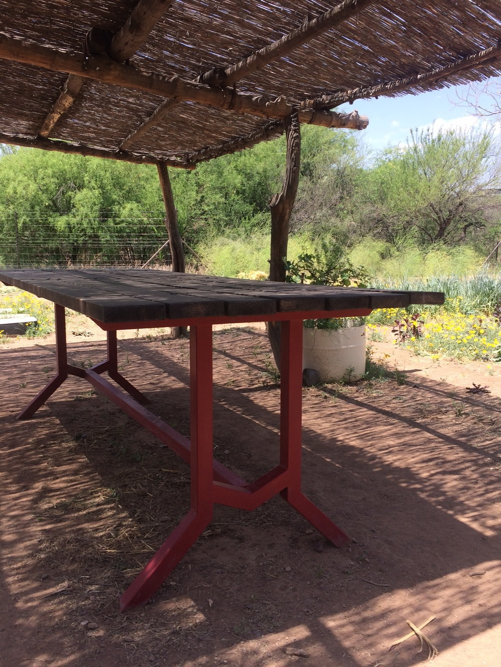 garden table under rustic ramada