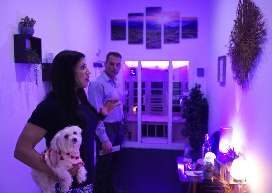 Jessica Chichester and Peter Chichester, owners of Haute Sauna, show one of the sauna rooms with their dog, Cookie, at Haute Sauna at 792 Pacific St., in Stamford, Conn., on Tuesday, Feb. 13, 2018.