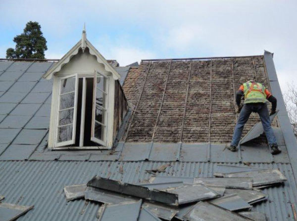 The original shingles of Cracroft House being revealed during demolition. Photo: I. Hill.