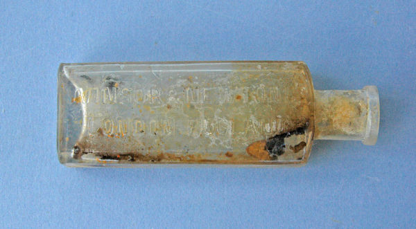 Winsor and Newton glass bottle found at the Williams House site. Winsor and Newton were famous suppliers of artist's materials from 1837 onwards, including inks and paints. Image: Kirsa Webb.