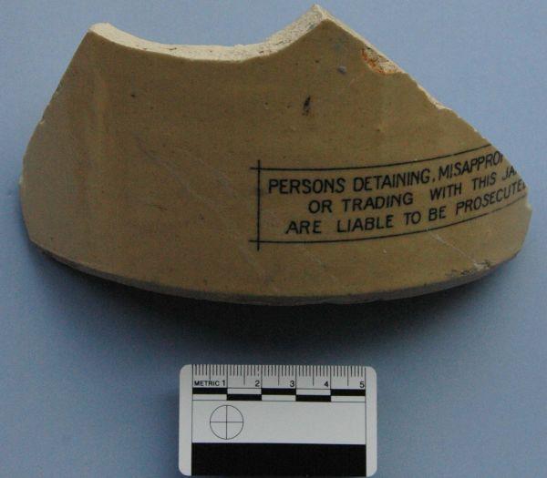 Warning label printed along the base of a jar. Image: Laura Davies