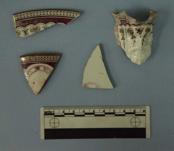 Fragments of a saucer, teacup and mask jug, decorated with the City Hotel pattern and the initials J. G. R.