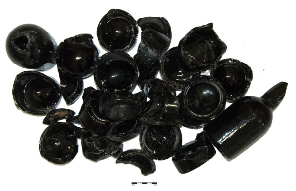 Some of the black beer bottles excavated from the Standard Hotel site in May 2013. Image: J. Garland.