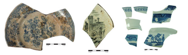 Left to right: a plate decorated with the Asiatic Pheasant pattern, fragment of a plate decorated with the Rhine pattern, and pieces of Cable and Willow pattern bowls.