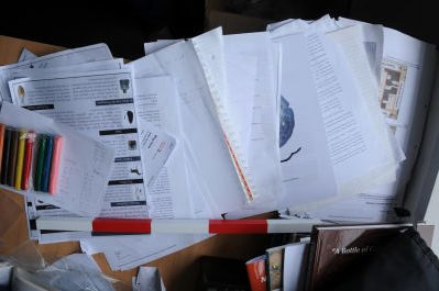 The pile of papers above, 'excavated'.