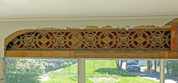 Hardboard was used on the exterior of the house too. To cover up weatherboards and this decorative cast iron frieze along the top of the veranda.