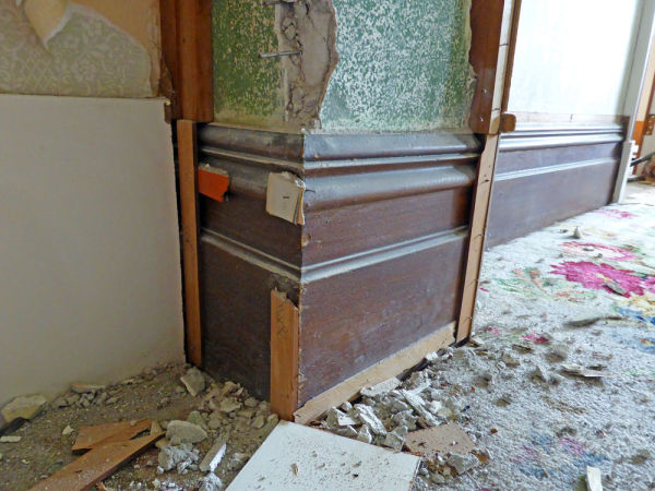 Through extensive use of the notorious hardboard previous owners of this house had gone to great lengths to cover nearly every inch of original decoration in the house. Every moulded shirting board, architrave and door panel was covered.
