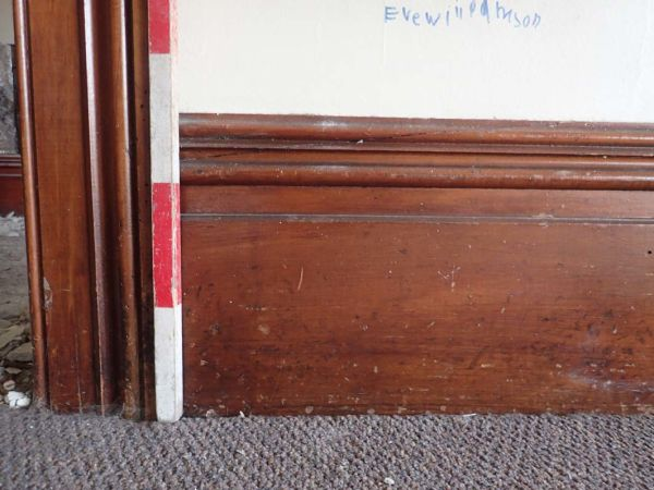 Traditional moulded skirting boards and architraves. These went out of fashion in the early 20th century as they became more expensive to produce. Note the child's scrawl. Touches like this remind us that these buildings were people's homes