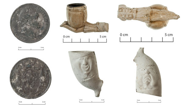 Some of the clay pipes found on site, along with an 1835 half-crown, with the stamp of William IV, King of England. Note the super awesome tragedy/comedy pipe with the face that changed expression when looked at upside down. Image: J. Garland.