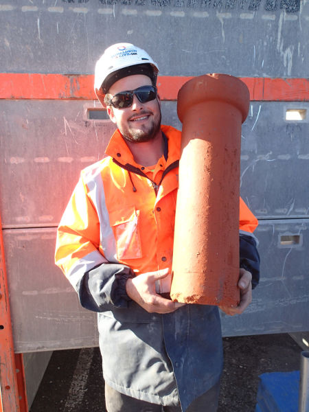 A very happy Ty Laskey from Donaldson Civil with one of these earthenware dewatering pipes we managed to recover intact. Unlike earthenware pipes for sewerage applications which are always glazed, these particular pipes were unglazed, and had been laid dry; that is to say without any cement mortar between the individual pipes to allow for the free infiltration of water. Image: Hamish Williams.