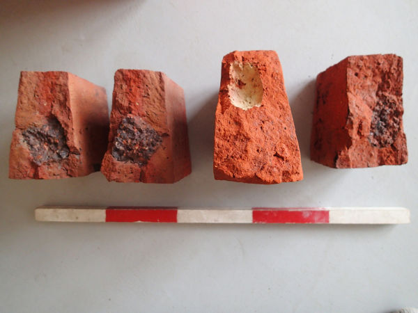 We didn't find much by way of artefacts in the backfill atop the sewer, with the exception of broken taper bricks. These bricks had evidently fractured because of the large clinkerous inclusions contained within. Useless for construction, they had been left by the bricklayer aside the crown arch.  Image: Hamish Williams