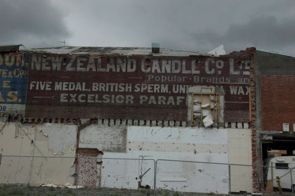 """A street sign advertising candles, including the brilliantly named """"Five medal British sperm"""" ones. Image: Underground Overground Archaeology."""