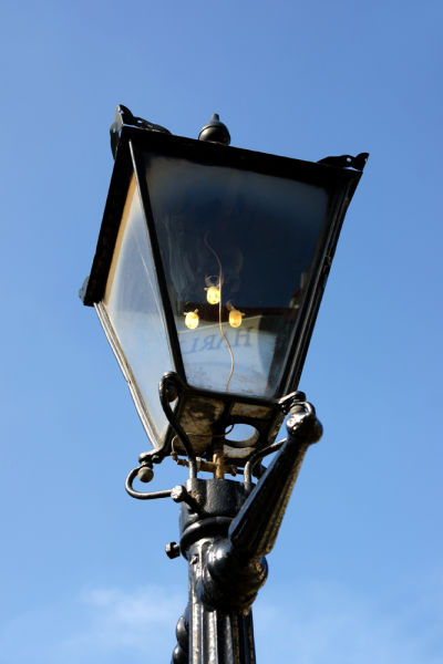 """The Canterbury Club Gas Light, still standing on Cambridge Terrace. As a side note, in the 19th century, publicans and hotel keepers were required by law to keep a light - like this one - burning outside their establishment throughout the night. There are several accounts of people being prosecuted for failing to do this, many of whom defended themselves with """"I can't help it if the light goes out while I'm sleeping."""" Image: Wikimedia Commons."""