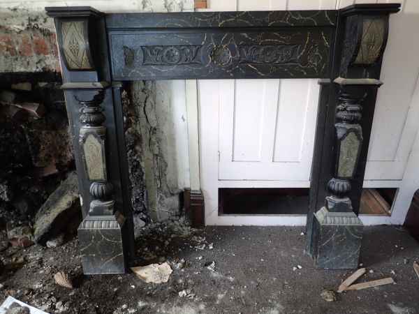 """Unfortunately, this beautifully ornate """"timber as marble"""" surround had been removed before it could be photographed in situ. Still, it's pretty cool. Image: P. Mitchell."""