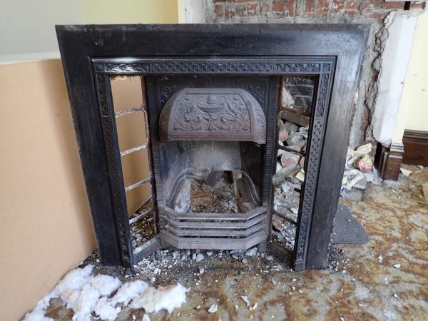 More ornate decoration, this time on the cast iron coal register, which has had its tiles removed. It probably went with the timber surround shown above. Image: P. Mitchell.