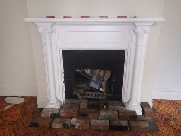 One of the more unusual fire surrounds we've come across, with neoclassical ionic columns featuring on either side. Image: p. Mitchell.