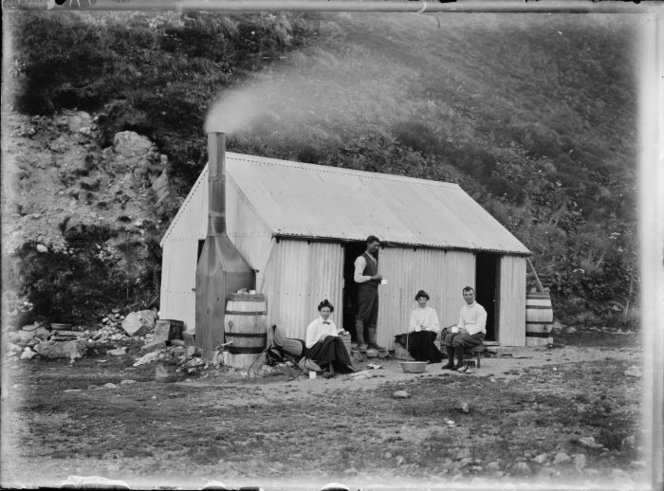 Ball hut, 1907. Earlier photographs indicate that it was built without a fireplace, or the capacity to capture rainwater. The archaeological remains indicate that the hut expanded a lot before being destroyed by an avalanche in 1925. Image: Gifford, Algernon Charles, 1862-1948. Gifford tramping party at Ball Hut, Mt Cook. Gifford, Algernon Charles, 1862-1948 : Albums and photographs. Ref: 1/2-060503-G. Alexander Turnbull Library, Wellington, New Zealand. http://natlib.govt.nz/records/22583972