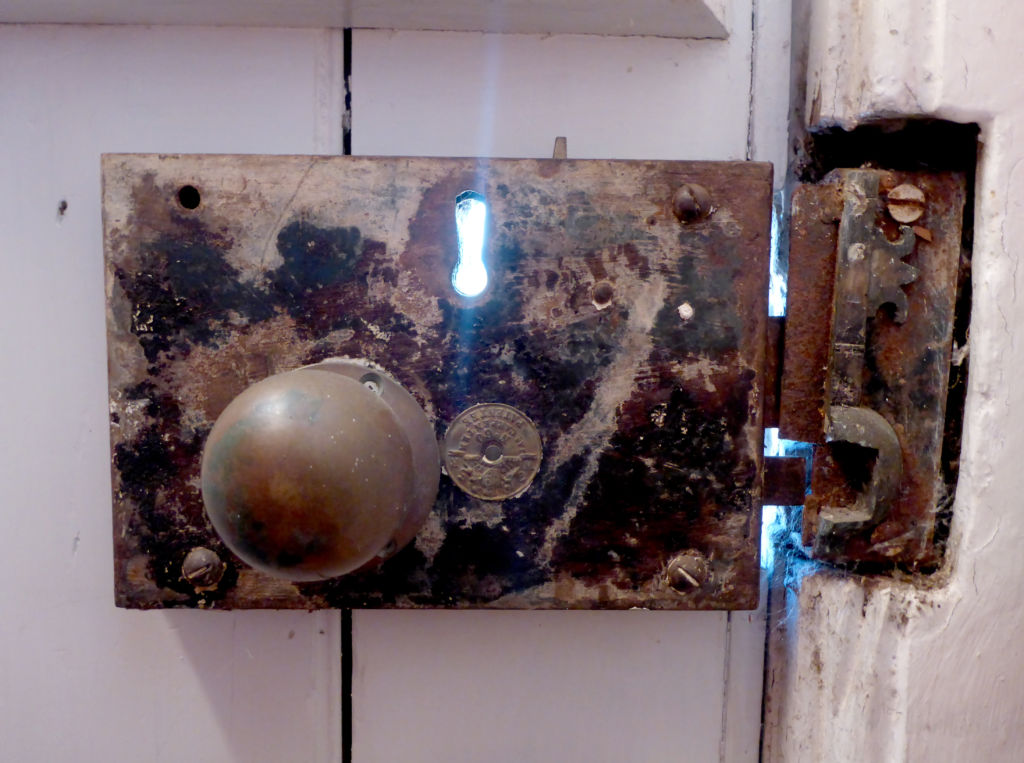 So, this is particularly cool. It's the front door lock to the cottage, but if you look closely you'll see that the door lock, key hole and escutcheon are upside down. On top of this, the hinge strike plate is shaped like a key, just to keep it all in theme. Image: L. Tremlett.