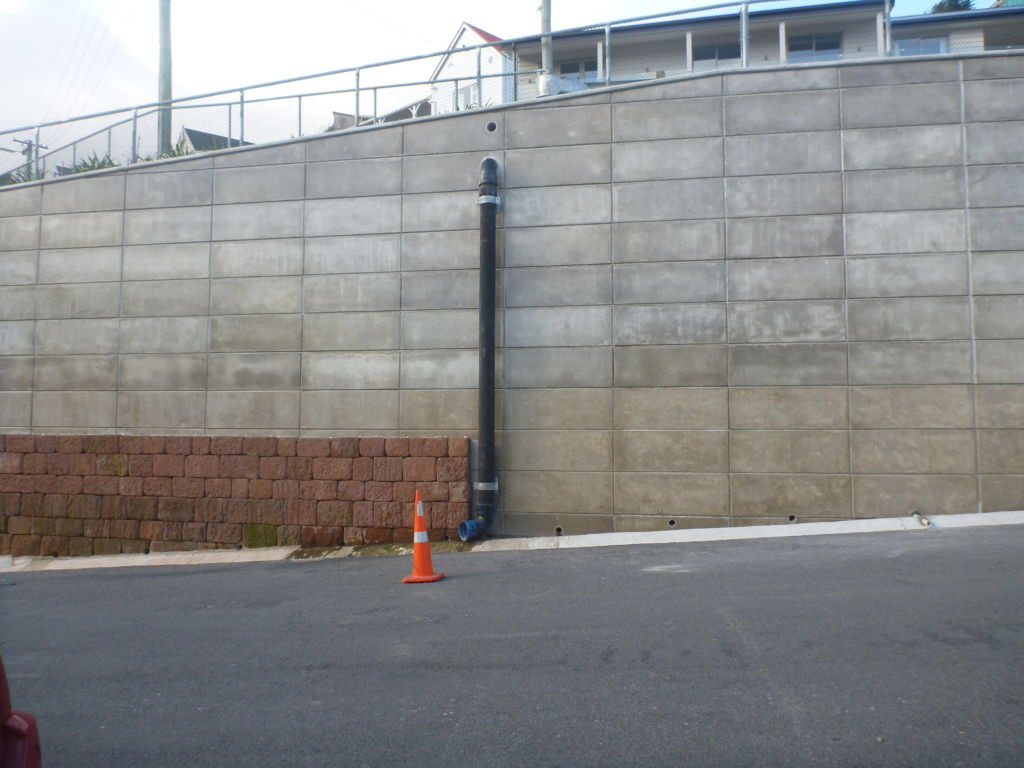 The newly constructed concrete wall on Sumner Road, with partial re-facing using the volcanic stone from the demolished wall. The re-facing will occur on as many of the key retaining walls across the town, as funding allows. Image: M. Hickey, 2016.