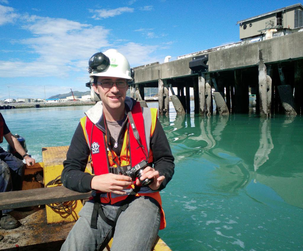 Luke records remnant 19th century wharf material in Lyttelton Harbour. Image Angel Trendafilov.