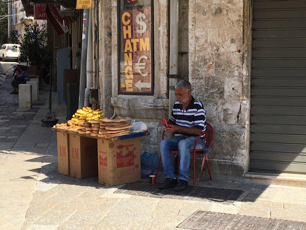 Vendor selling bread in Jerusalem