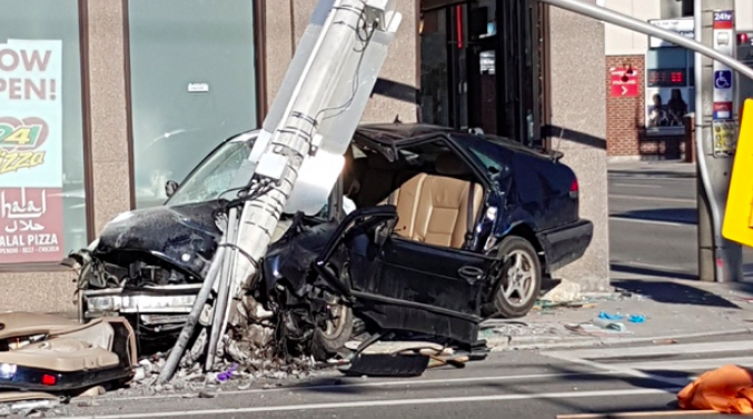 Man seriously hurt after car strikes pole in Corktown - A man is in serious but non-life-threatening condition after a vehicle hit a pole and then the front of a pizza store in Toronto's Corktown neighbourhood on Sunday morning.