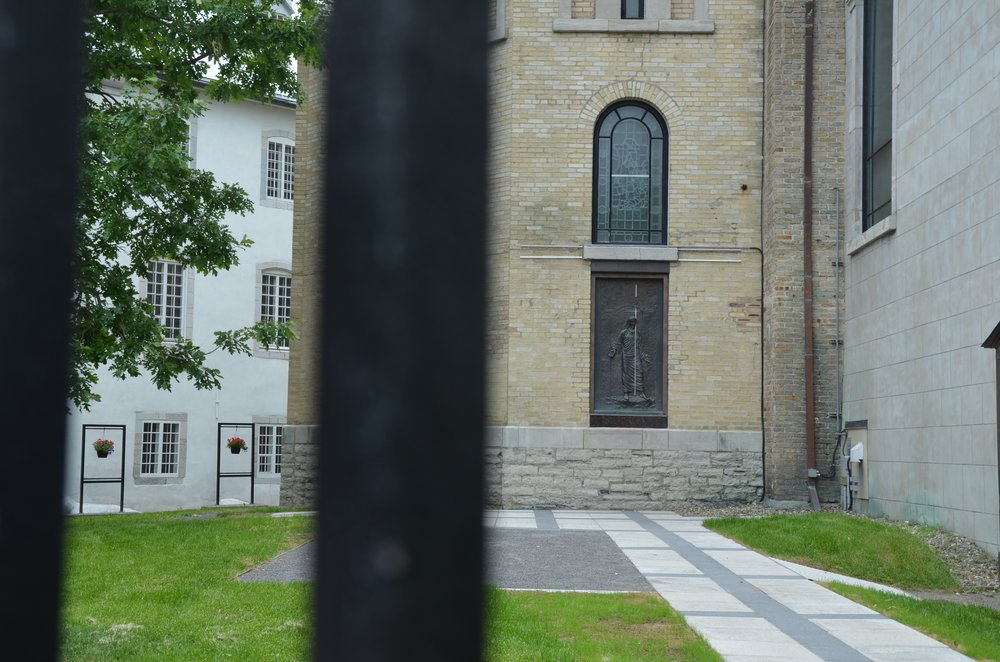 The Holy Door through the fence of the cathedral.