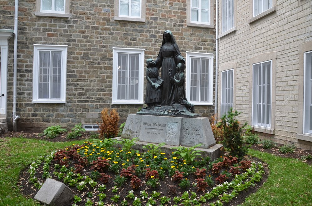 A statue of Ursuline nun Marie de l'Incarnation, who helped spread Catholicism in New France.