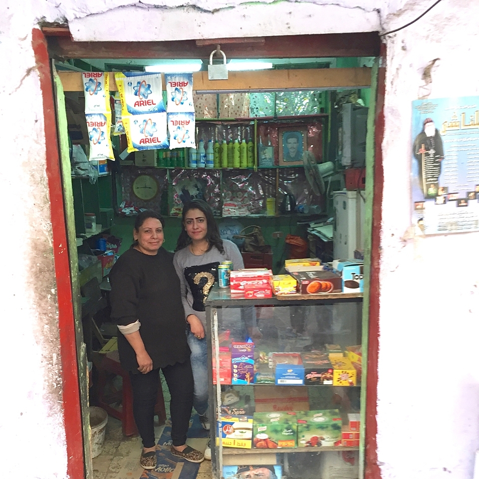 Heba* had an open room below her apartment; with her TOLI loan, she built display cases, bought a refrigerator, and stocked her small shop. She serves cold drinks and provides daily needs for her neighbors.