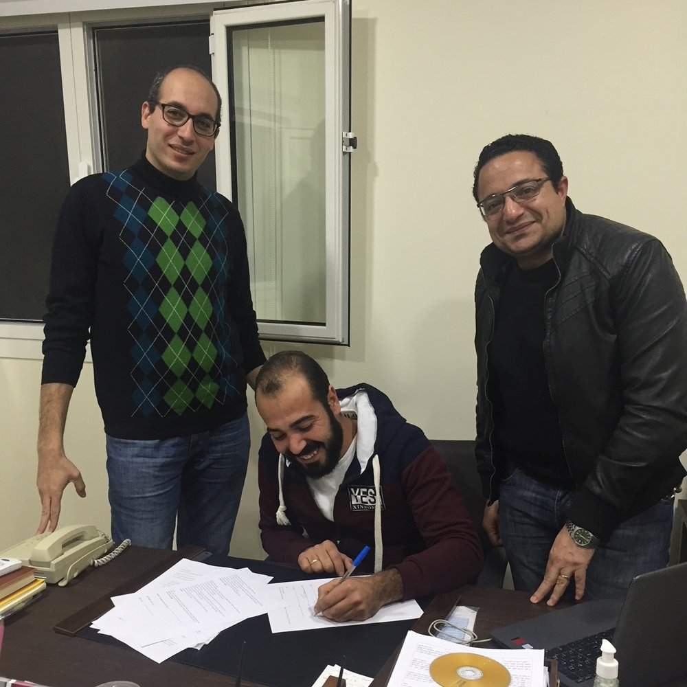 Our new social worker Mario (center) with the Pastor Amir and Abd el Massieh of Haggana church outside of Cairo.