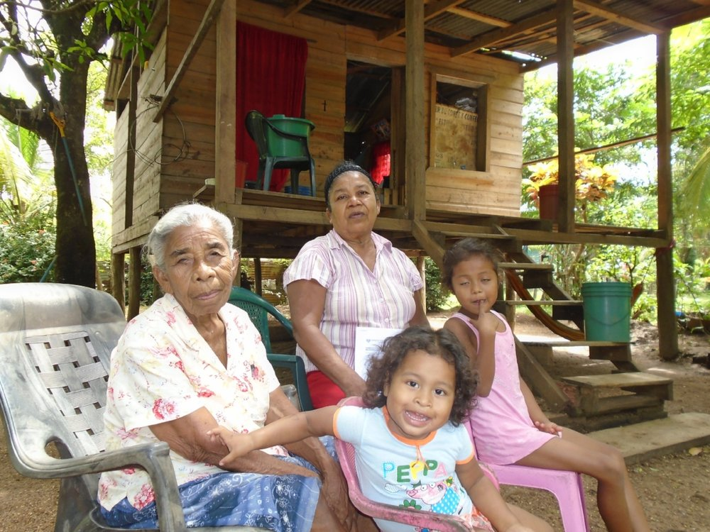In Nicaragua, Sedy (center) took a loan this month to build her sewing business. Her new business will help her care for her elderly mother (left) and her grandchildren.