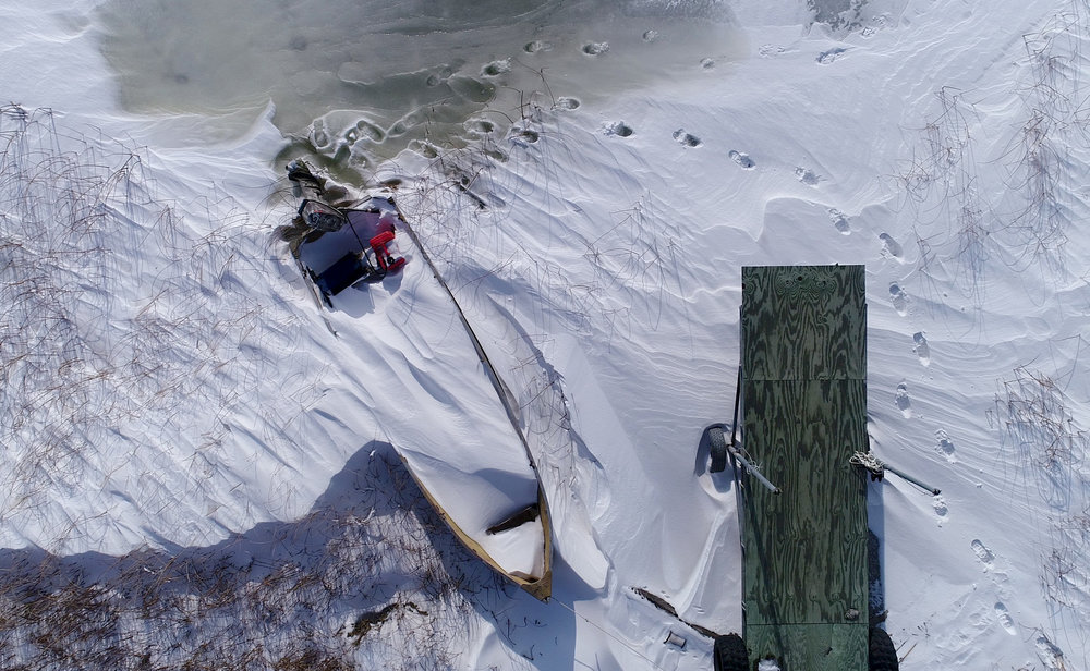 This boat is trapped in the snow and ice until spring in Kidder County, North Dakota.
