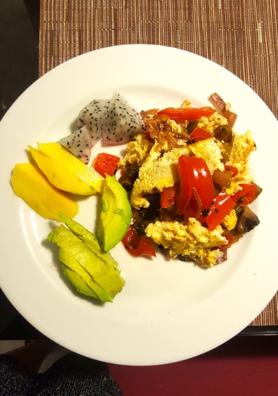 Breakfast scramble with cactus, red peppers, mushrooms, avocado, chili lime salt, Himalayan salt, topped with avocado and salsa and served with mango and dragonfruit! Not the best pic sorry!